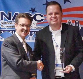 Michael Castellon Accepts NAGC Award